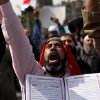 Egyptian Salafi Muslims chant slogans during a protest in support of the bearded police officers who were prevented from carrying out their work in the interior ministry, in front of Abdeen presidential palace in downtown Cairo, Egypt, Friday, March 1, 2013. (AP Photo/Khalil Hamra)