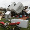 A camper is overturned among the damage to the home of Jerry Dye in the Brewer community 4 in Lee County near Tupelo, Miss. Another night of severe weather has left four people dead in Mississippi, including a Louisiana police officer who was out camping with his daughter, raising the state\'s total death toll to at least five. (AP Photo/The Northeast Mississippi Daily Journal, C. Todd Sherman)