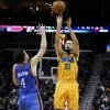 New Orleans Ryan Anderson (33) shoots the ball over Oklahoma City\'s Nick Collison (4) during the second half of an NBA basketball game in New Orleans, Friday, Nov. 16, 2012. The Thunder won 110-95. (AP Photo/Jonathan Bachman) ORG XMIT: LAJB113