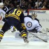 Buffalo Sabres\' center Cody Hodgson (19) shoots against Winnipeg Jets goaltender Ondrej Pavelec, (31), of the Czech Republic, during the first period of an NHL hockey game in Buffalo, N.Y., Tuesday, Feb. 19, 2013. (AP Photo/Gary Wiepert)