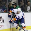 New York Islanders\' Andrew MacDonald (47) attempts to gain control of the puck behind the net as Dallas Stars\' Cody Eakin, rear, pressures in the first period of an NHL hockey game, Sunday, Jan. 12, 2014, in Dallas. (AP Photo/Tony Gutierrez)
