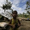 A child stands near his family\'s damaged house Wednesday Dec. 5, 2012, a day after powerful Typhoon Bopha hit Montevista township Compostela Valley in southern Philippines. Typhoon Bopha, one of the strongest typhoons to hit the Philippines this year, barreled across the country\'s south on Tuesday, killing scores of people while triggering landslides, flooding and cutting off power in two entire provinces. (AP Photo/Bullit Marquez)