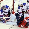 Washington Capitals center Brooks Laich (21) gets tripped up in front of New York Rangers goalie Henrik Lundqvist (30) and defenseman Anton Stralman (32) during the first period of Game 3 of their NHL hockey Stanley Cup second-round playoff series at the Verizon Center in Washington, Wednesday, May 2, 2012. (AP Photo/Susan Walsh)