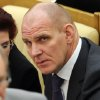Russian lawmaker, ruling United Russia Party member, three-time Russian Olympic champion Alexander Karelin, former wrestler, listens during a parliament session in Moscow, Wednesday, Feb. 13, 2013. Karelin noted in an interview with Vyes\' Sport that Russians and Soviets have won 77 gold medals.