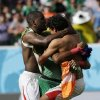 Photo - Costa Rica players embrace Costa Rica's goalkeeper Keylor Navas following the team's 1-0 victory over Italy during the group D World Cup soccer match between Italy and Costa Rica at the Arena Pernambuco in Recife, Brazil, Friday, June 20, 2014.  (AP Photo/Ricardo Mazalan)