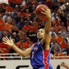 KU\'s Xavier Henry (1) shoots over Keiton Page (12) of OSU in the second half during the men\'s college basketball game between the University of Kansas (KU) and Oklahoma State University (OSU) at Gallagher-Iba Arena in Stillwater, Okla., Saturday, Feb. 27, 2010. OSU won, 85-77. Photo by Nate Billings, The Oklahoman