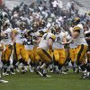 Photo -   Iowa players celebrate their 19-16 double-overtime win over Michigan State in an NCAA college football game as Michigan State's Bennie Fowler (13) walks off the field, Saturday, Oct. 13, 2012, in East Lansing, Mich. (AP Photo/Al Goldis)