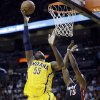 Photo - Indiana Pacers' Roy Hibbert (55) goes up to the basket as Miami Heat's Mario Chalmers (15) defends during the first half of an NBA basketball game in Miami, Sunday, March 10, 2013. (AP Photo/Alan Diaz)