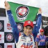 Photo - Takuma Sato, of Japan, celebrates after qualifying for the pole position for the IndyCar Firestone Grand Prix of St. Petersburg auto race Saturday, March 29, 2014, in St. Petersburg, Fla. (AP Photo/Chris O'Meara)