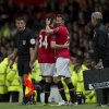 Photo - Manchester United's interim manager Ryan Giggs, right, embraces teammate Tom Lawrence as he takes to the pitch as a substitute during his team's English Premier League soccer match against Hull at Old Trafford Stadium, Manchester, England, Tuesday May 6, 2014. (AP Photo/Jon Super)
