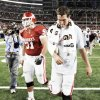 Photo - Oklahoma quarterback Sam Bradford, right, walks off the field next to Brian Lepak on Saturday after OU lost to  Brigham Young University  at Cowboys Stadium in Arlington, Texas.    PHOTO By Nate Billings,  The Oklahoman