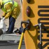 A San Bernardino County firefighter paramedic treats one of the students injured in a school bus rollover in Victorville Calif. Thursday October 11, 2012. A school bus carrying 40 children in Southern California has been knocked on its side in a crash that has injured 13 children and the bus driver. (AP Photo/The Victor Valley Daily Press, James Quigg)