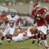Oklahoma\'s Kenny Stills (4) fights off Florida A&M Rattlers defensive back Jonathan Pillow (19) during the college football game between the University of Oklahoma Sooners (OU) and Florida A&M Rattlers at Gaylord Family-Oklahoma Memorial Stadium in Norman, Okla., Saturday, Sept. 8, 2012. Photo by Bryan Terry, The Oklahoman