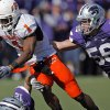Oklahoma State\'s Joseph Randle (1) gets past Kansas State\'s Alex Hrebec (56) during the second half of the college football game between the Oklahoma State University Cowboys (OSU) and the Kansas State University Wildcats (KSU) on Saturday, Oct. 30, 2010, in Manhattan, Kan. Photo by Chris Landsberger, The Oklahoman