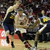 Houston Rockets\' Chandler Parsons, center, drives between Utah Jazz defenders Gordon Hayward (20) and Jeremy Evans (40) in the first half of an NBA basketball game on Saturday, Dec. 1, 2012, in Houston. (AP Photo/Pat Sullivan)