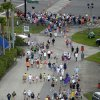 Photo - Fans leave the track after a rainstorm caused a second red-flag delay during a NASCAR Sprint Cup Series auto race at the Daytona International Speedway in Daytona Beach, Fla., Sunday, July 6, 2014.(AP Photo/Phelan M. Ebenhack)