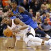 Oklahoma City\'s Kevin Durant (35) gains control of the ball in front of Dallas\' O.J. Mayo (32) during an NBA basketball game between the Oklahoma City Thunder and the Dallas Mavericks at Chesapeake Energy Arena in Oklahoma City, Thursday, Dec. 27, 2012. Oklahoma City won 111-105. Photo by Bryan Terry, The Oklahoman