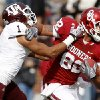 Oklahoma\'s Roy Finch (22) fights off Texas A&M\'s Trent Hunter (1) during the college football game between the Texas A&M Aggies and the University of Oklahoma Sooners (OU) at Gaylord Family-Oklahoma Memorial Stadium on Saturday, Nov. 5, 2011, in Norman, Okla. Oklahoma won 41-25. Photo by Bryan Terry, The Oklahoman