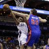 Charlotte Bobcats\' Gerald Henderson (9) is fouled by Detroit Pistons\' Viacheslav Kravtsov (55) during the first half of an NBA basketball game in Charlotte, N.C., Wednesday, Feb. 20, 2013. (AP Photo/Chuck Burton)