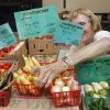 Juanola Garriott sets out produce at the Farmer\'s Market at the Cleveland County Fairgrounds on Saturday, July 16, 2011, in Norman, Okla. Photo by Steve Sisney, The Oklahoman