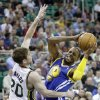 Photo - Utah Jazz forward Gordon Hayward (20) defends Golden State Warriors guard Andre Iguodala (9) in the second quarter during an NBA preseason basketball game Tuesday, Oct. 8, 2013, in Salt Lake City. (AP Photo/Rick Bowmer)