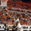 Oklahoma State\'s Le\'Bryan Nash (2) is fouled by Portland State\'s Dre Winston Jr. (3) and Portland State\'s Michael Harthun (4) during the college basketball game between Oklahoma State University and Portland State, Sunday,Nov. 25, 2012. Photo by Sarah Phipps, The Oklahoman