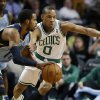 Boston Celtics point guard Avery Bradley (0) defends against Memphis Grizzlies point guard Mike Conley (11) during the first quarter of an NBA basketball game in Boston, Wednesday, Jan. 2, 2013. (AP Photo/Elise Amendola)
