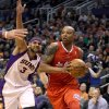 Los Angeles Clippers\' Caron Butler, right, drives the baseline past Phoenix Suns\' Jared Dudley during the first half of an NBA basketball game Sunday, Dec. 23, 2012, in Phoenix. (AP Photo/Ralph Freso)