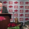 New Arkansas head coach Bret Bielema, left, speaks during an NCAA college football news conference in Fayetteville, Ark., Wednesday, Dec. 5, 2012. At center and right are Bielema\'s wife Jen and athletic director Jeff Long. Bielema, who will be paid $3.2 million annually for six years, replaces interim coach John L. Smith, who was hired after Bobby Petrino was fired in April. (AP Photo/April L. Brown)