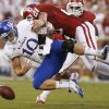 KU\'s Dayne Crist (10) fumbles the ball as OU\'s Tom Wort (21) brings him down during the college football game between the University of Oklahoma Sooners (OU) and the Kansas Jayhawks (KU) at Gaylord Family-Oklahoma Memorial Stadium in Norman, Okla., Saturday, Oct. 20, 2012. Photo by Bryan Terry, The Oklahoman