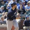 Photo -   Milwaukee Brewers' Jonathan Lucroy watches after hitting a grand slam against the Chicago Cubs during the third inning of a baseball game in Chicago, Thursday, Aug. 30, 2012. (AP Photo/Nam Y. Huh)
