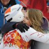 Photo - United States' Bode Miller embraces his wife Morgan near the finish area after completing Men's super combined downhill training at the Sochi 2014 Winter Olympics, Tuesday, Feb. 11, 2014, in Krasnaya Polyana, Russia. (AP Photo/Christophe Ena)