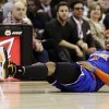 New York Knicks\' Carmelo Anthony grimaces after falling in the second quarter of an NBA basketball game against the Cleveland Cavaliers, Monday, March 4, 2013, in Cleveland. (AP Photo/Tony Dejak)