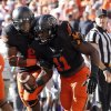Oklahoma State\'s Daytawion Lowe (8) and Shaun Lewis (11) celebrate a fumble during the second half of a college football game between the Oklahoma State University Cowboys (OSU) and the Kansas State University Wildcats (KSU) at Boone Pickens Stadium in Stillwater, Okla., Saturday, Oct. 5, 2013. OSU won 33-29.Photo by Sarah Phipps, The Oklahoman