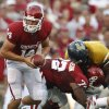 OU: University of Oklahoma quarterback Sam Bradford, left, prepares to hand off in a college football game against Chattanooga in Norman, Okla., Saturday, Aug. 30, 2008. (AP Photo) ORG XMIT: OKSO110