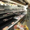 Maj. Ryan Burke scans the nearly empty shelves in the meat section at the Fort Carson Commissary in Colorado Springs, Colo., Tuesday, Oct. 1, 2013. The commissary was busier than normal with news that it will close until further notice because of the government shutdown. (AP Photo/The Colorado Springs Gazette, Mark Reis) MAGS OUT