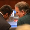 Photo - Defense attorney Cory Strolla, left, talks with Michael Dunn during the first day of Dunn's trial in Jacksonville, Fla., Thursday Feb. 6, 2014. Michael Dunn is charged in the shooting death of Jordan Davis who was outside a Jacksonville store with friends in November 2012. (AP Photo/Bob Mack, Pool)