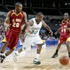 Nic Combs of Edmond Santa Fe, center, with Brentrell Friday and Eric Johnson of Putnam City North chase down the ball during the class 6A boys state basketball semifinal at the Ford Center in Oklahoma City, Friday March 7, 2008. BY BRYAN TERRY, THE OKLAHOMAN