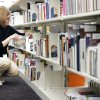 Library aide Jessica Little shelves reserved books as a part of the self-serve reserve system at the Edmond branch of the Metropolitan Library System. Photos By Paul Hellstern, The Oklahoman archives