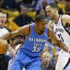 Photo - Oklahoma City Thunder forward Kevin Durant (35) drives against Memphis Grizzlies forward Tayshaun Prince (21) in the first half of Game 6 of an opening-round NBA basketball playoff series Thursday, May 1, 2014, in Memphis, Tenn. (AP Photo/Mark Humphrey)