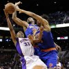 New York Knicks\' Marcus Camby, rear, and Chris Copeland defend against Phoenix Suns\' Sebastian Telfair (31) during the second half of an NBA basketball game, Wednesday, Dec. 26, 2012, in Phoenix. The Knicks won 99-97. (AP Photo/Matt York)