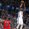 Oklahoma City\'s Kevin Durant (35) shoots in front of Portland\'s Damian Lillard (0) during the NBA basketball game between the Oklahoma City Thunder and the Portland Trail Blazers at the Chesapeake Energy Arena in Oklahoma City, Sunday, March, 24, 2013. Photo by Sarah Phipps, The Oklahoman