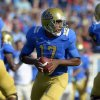 Photo -   UCLA quarterback Brett Hundley gets set to pass during the first half of their NCAA football game against Nebraska, Saturday, Sept. 8, 2012, in Pasadena, Calif. (AP Photo/Mark J. Terrill)