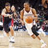 Thunder guard Russell Westbrook drives to the basket during Oklahoma City's loss to the Cleveland Cavaliers on Dec. 13. Westbrook averaged 7.5 assists per game against 2.5 turnovers per game during the month of December. PHOTO BY SARAH PHIPPS, THE OKLAHOMAN