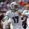 Photo - Miami Dolphins quarterback Ryan Tannehill (17) looks to pass during the first half of an NFL football game against the New England Patriots, Sunday, Dec. 2, 2012 in Miami. (AP Photo/John Bazemore)