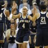 Photo - Notre Dame's Skylar Diggins (4) high-fives teammates Ariel Braker (44) and Kayla McBride (21) during the first half of an NCAA college basketball game against Connecticut in Storrs, Conn., Saturday, Jan. 5, 2013. (AP Photo/Jessica Hill)