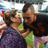 Photo - Miami Marlins starting pitcher Jose Fernandez pitcher kissed his grandmother Olga Fernandez before the 2014 Opening Day baseball game against the Colorado Rockies at the Marlins Park, in Miami on Monday, March 31, 2014. (AP Photo/El Nuevo Herald, Hector Gabino)