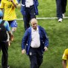 Photo - Brazil's coach Luiz Felipe Scolari leaves the pitch after the World Cup semifinal soccer match between Brazil and Germany at the Mineirao Stadium in Belo Horizonte, Brazil, Tuesday, July 8, 2014. Germany won 7-1.(AP Photo/Hassan Ammar)