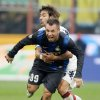 Photo -   Inter Milan forward Antonio Cassano, foreground, challenges for the ball with Cagliari midfielder Daniele Conti during the Serie A soccer match between Inter Milan and Cagliari at the San Siro stadium in Milan, Italy, Sunday, Nov. 18, 2012. (AP Photo/Antonio Calanni)