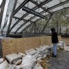 Photo -   FILE - This Oct. 30, 2012 file photo shows man peering into the closed Bowling Green subway station in New York, after Superstorm Sandy his the east Coast. Extreme weather is a growing threat to the nation's lifelines _ its roads, bridges, railways, airports and transit systems _ leaving states and cities trying to come to terms with a new normal. (AP Photo/Richard Drew, File)